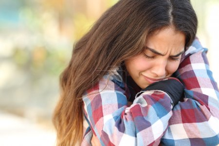Photo for Close up of a teenager girl worried and sad crying outdoors - Royalty Free Image