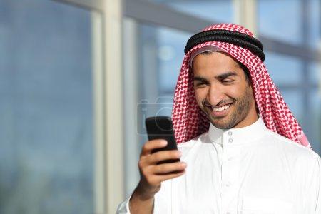 Arab saudi businessman working  with his phone