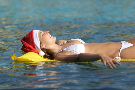 Woman enjoying on the beach on christmas holidays