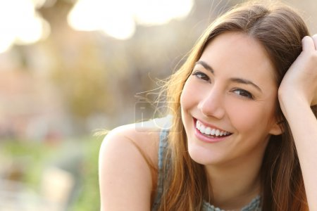 Woman smiling with perfect smile and white teeth i...
