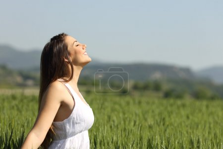 Girl breathing fresh air with white dress