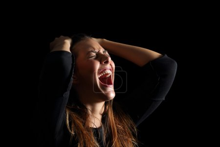 Depressed woman crying and shouting desperately is...