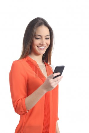Woman wearing an orange shirt using a mobile phone