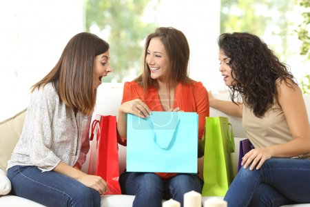 Happy shoppers with shopping bags
