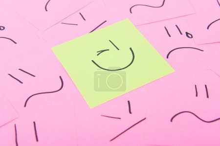 Yellow post it with happy face