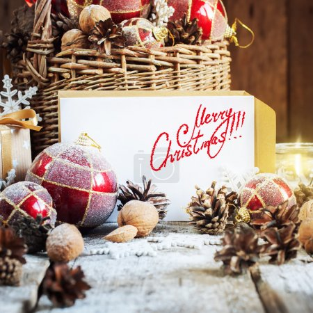 Photo for Card with Isolated text Merry Christmas on Letter and Brights Retro Fir Tree Toys, Basket Burning Candle. Gifts in Christmas Composition. Isolated text - Royalty Free Image