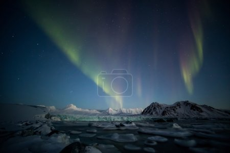 Northern Lights over the tidewater Arctic glacier - Spitsbergen