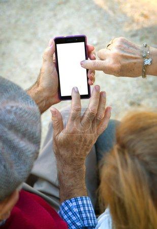 Hand senior man an woman using Cell phone