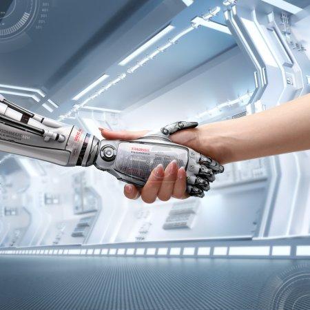 Photo pour Poignée de main de l'homme et du robot féminin comme symbole de connexion entre les personnes et technologie d'intelligence artificielle - image libre de droit