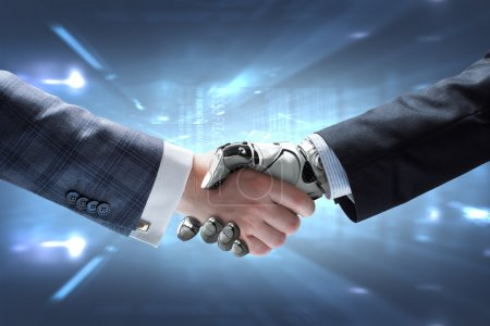 Business Human and Robot hands in handshake. Artif...