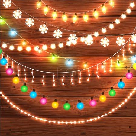 Photo pour Ensemble de lumières de Noël éclatantes pour Noël Cartes de voeux de Noël Design. Fond dessiné à la main en bois. Collection d'ampoules - image libre de droit