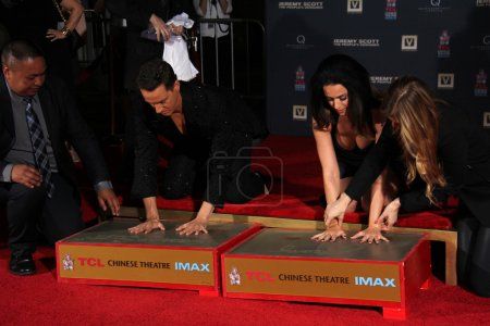 Photo for Jeremy Scott, Katy Perry at the Jeremy Scott and Katy Perry Handprints in Cement Ceremony, TCL Chinese Theater, Hollywood, CA 09-08-15 - Royalty Free Image