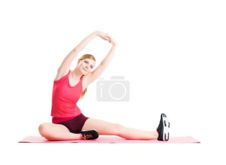Photo for Fit, healthy and sporty woman in sportswear making physical exercises isolated on white. - Royalty Free Image
