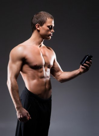 man with a bottle of sport supplements