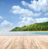 Wooden pier, sea and a blue sky