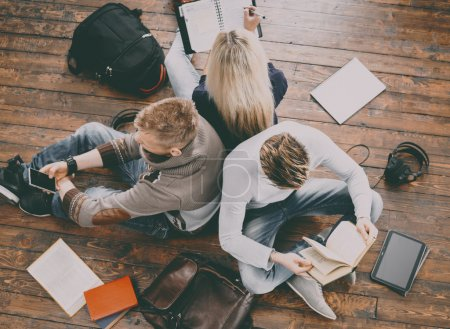 Group of students reading books