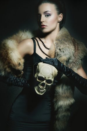 Attractive young lady with scull