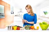 Woman in   modern kitchen