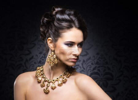 Woman in jewels of gold and stones