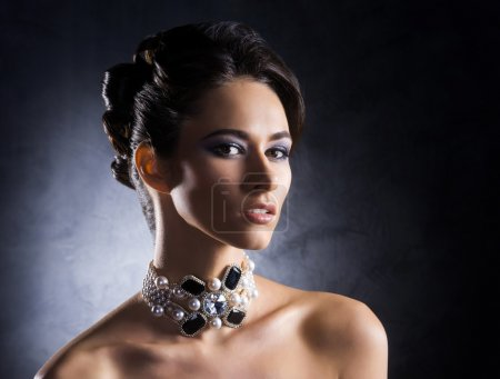 Beautiful and rich woman in jewels