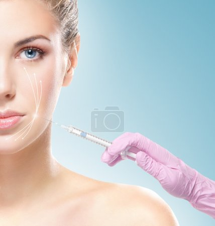 Beautiful woman gets  injection in face
