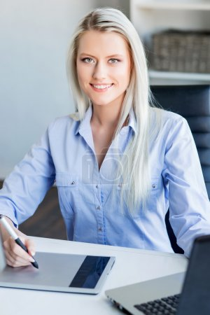 confident  woman working in office