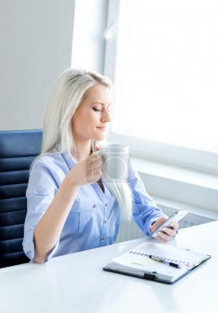 confident business woman working in office