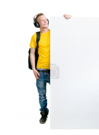 man in headphones holding blank banner