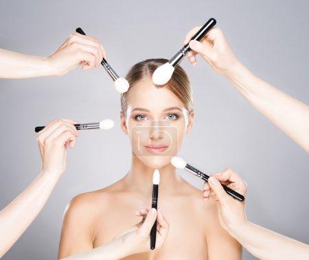 woman  having  procedure of applying make-up