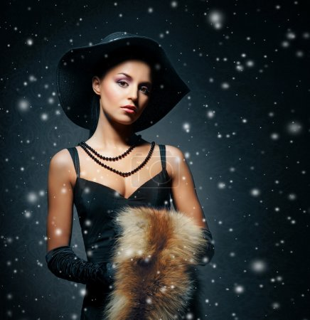 Photo for Young, rich and beautiful woman over the vintage winter background. - Royalty Free Image