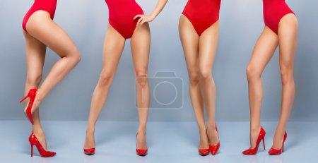 Beautiful legs of  women in red swimsuits