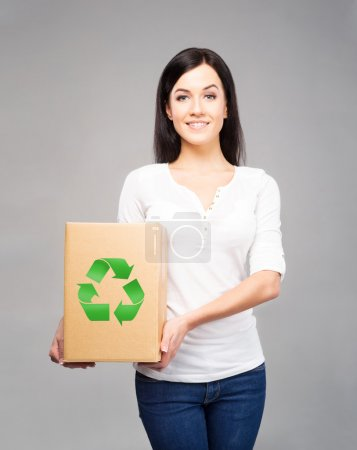 Young and attractive girl with a cardboard box