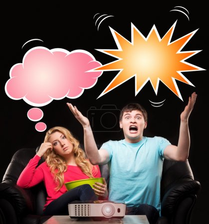 Young couple watching movie or sport broadcast on tv sitting