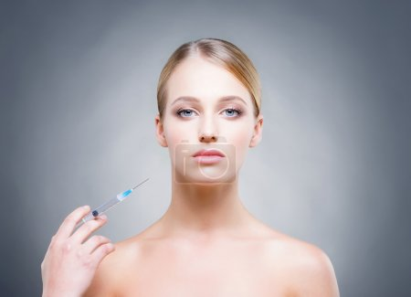 Beautiful woman pampering herself in the beauty clinic