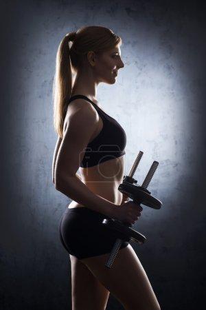 woman having a dumbbell training