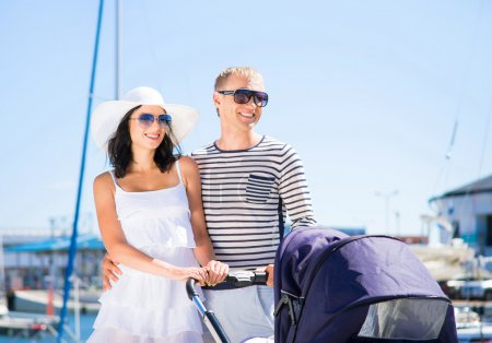 couple walking with a baby pram outdoor