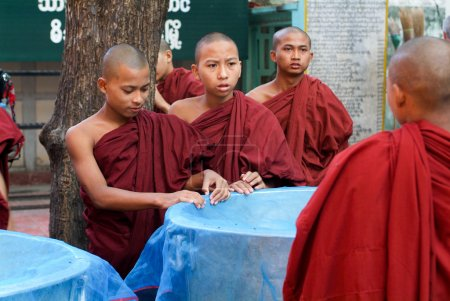 Monks in a row at Mahagandayon Monastery