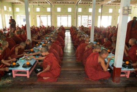 Monks eating at Mahagandayon Monastery in Mandalay, Myanmar