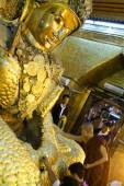 The Myanmar people venerated Buddha statue with the golden paper