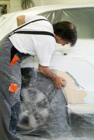 Mechanic reparing a car in auto repair shop