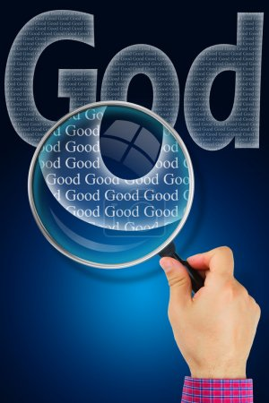 The name GOD under observation with magnifying glass - God is Go