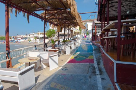 MATALA,CRETE-JULY 22: Colorful street in Matala village on July 22,2014 on the island of Crete, Greece. Matala is a village located 75 km south-west of Heraklion, Crete.