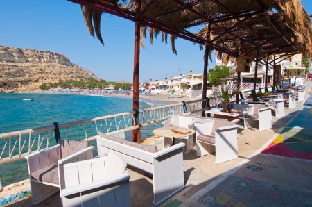 MATALA,CRETE-JULY 22: Local restaurant in Matala village on July 22,2014 on the island of Crete, Greece. Matala is a village located 75 km south-west of Heraklion, Crete.