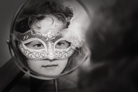 Black and white portrait of a beautiful girl in carnival mask lo