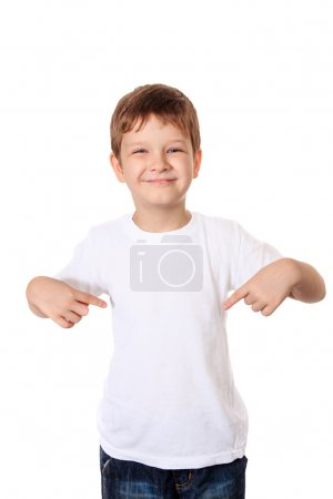 Happy little boy pointing his fingers on a blank t-shirt, a plac