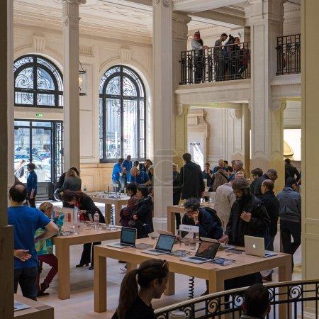 People inside Apple Store in Paris