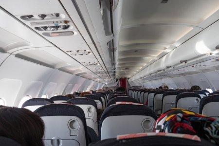 Photo pour Avions Jet vue intérieure avec des personnes non identifiées. - image libre de droit