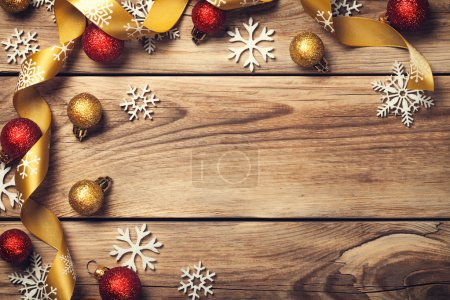 Photo for Christmas background with snowflakes, red and gold balls on wooden table. Copy space. Top view - Royalty Free Image