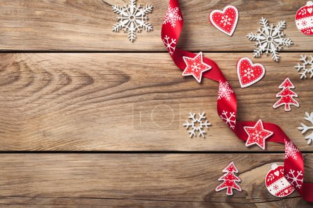 Photo for Christmas background with snowflakes and red decoration on wooden table. Copy space. Top view - Royalty Free Image