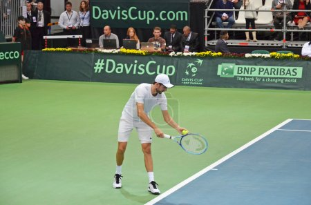 Photo for Irkutsk, Russia-Sept,19 2015: Konstantin Kravchuk serve. Davis Cup World Group Play-offs. Russia - Italy. Sports Palace 'Baikal-Arena', Irkutsk, RUS (hard - indoors) - Royalty Free Image
